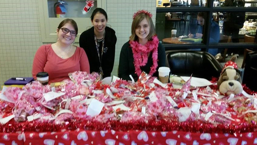 "Member Recruitment: Members selling cookies at our annual ""Sonnet Sale."""